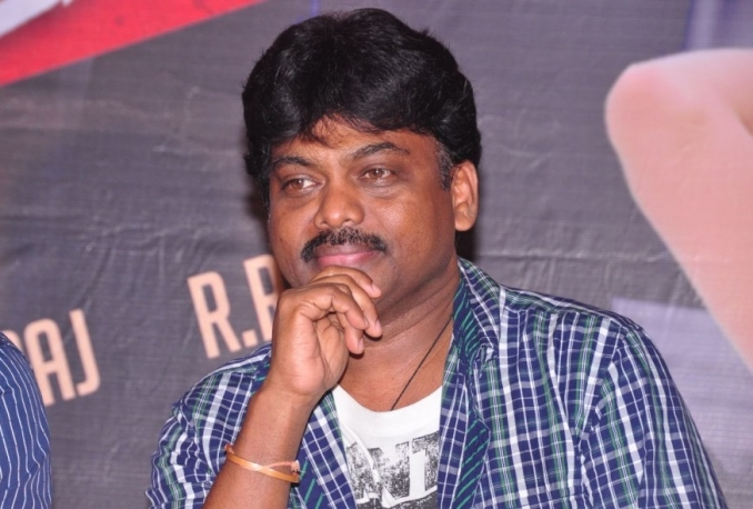 give Director Karunakaran's contact details